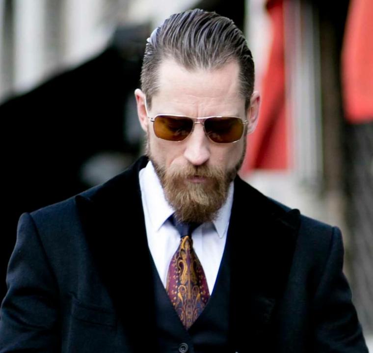 Sfumatura taglio capelli uomo, viso con barba e occhiali da sole, uomo con cravatta