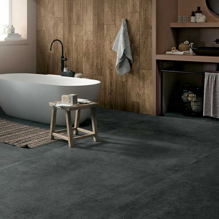 bagno vasca sedia armadio legno piastrelle ceramica pietra naturale lavandino tappetino