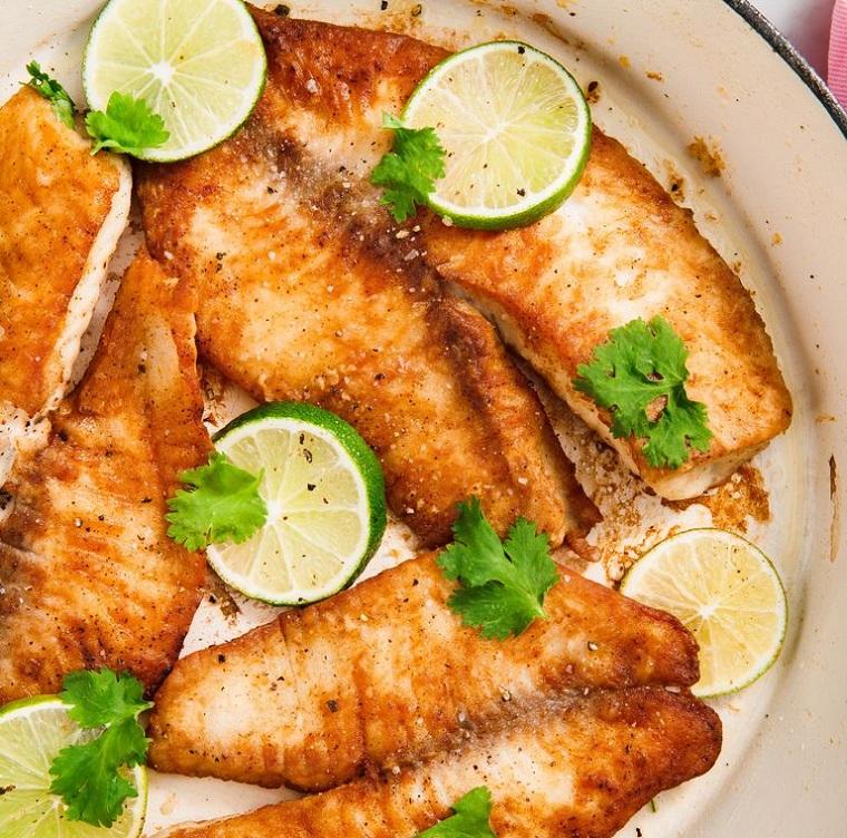 cena veloce e appetitosa pesce tilapia saltata in padella limone prezzemolo