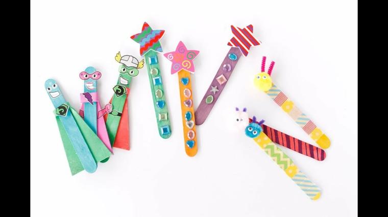 Fai da te con bastoncini di legno, stecche di gelato decorati con brillantini e nastri washi tape