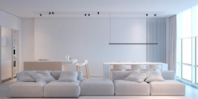 arredare ambiente unico cucina soggiorno divano bianco tavolo da pranzo lampadario