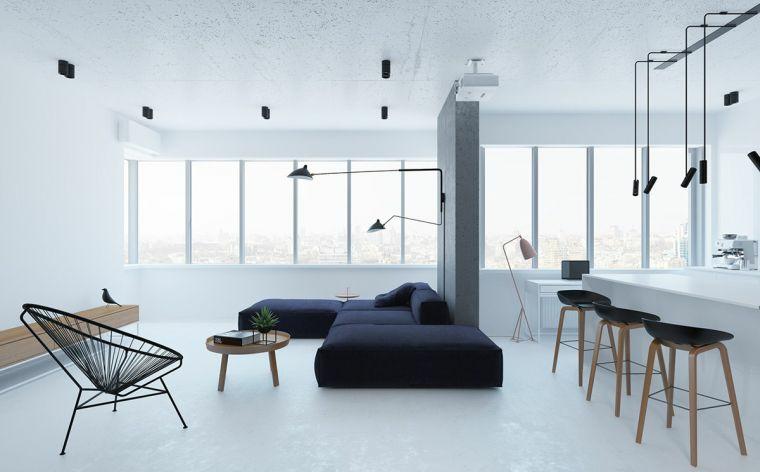 arredare ambiente unico cucina soggiorno divano blu sedia isola centrale lampadari