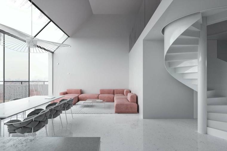 arredare ambiente unico cucina soggiorno divano rosa angolare tavolo da pranzo sedie scale interne
