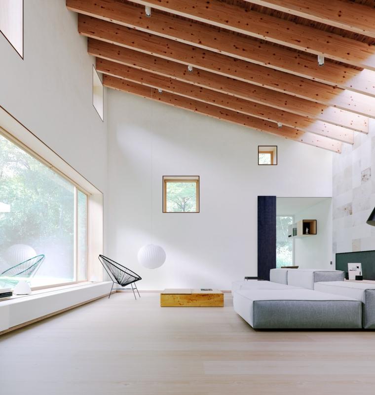 arredare ambiente unico cucina soggiorno divano tessuto poltrona travi legno