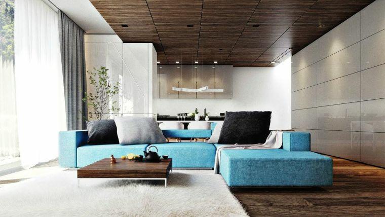 come arredare un salotto divano blu tavolino basso legno tappeto soffitto faretti cucina open space