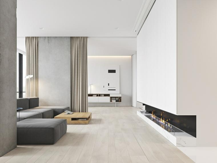 come arredare un salotto divano grigio tavolino camino parete bianca cucina