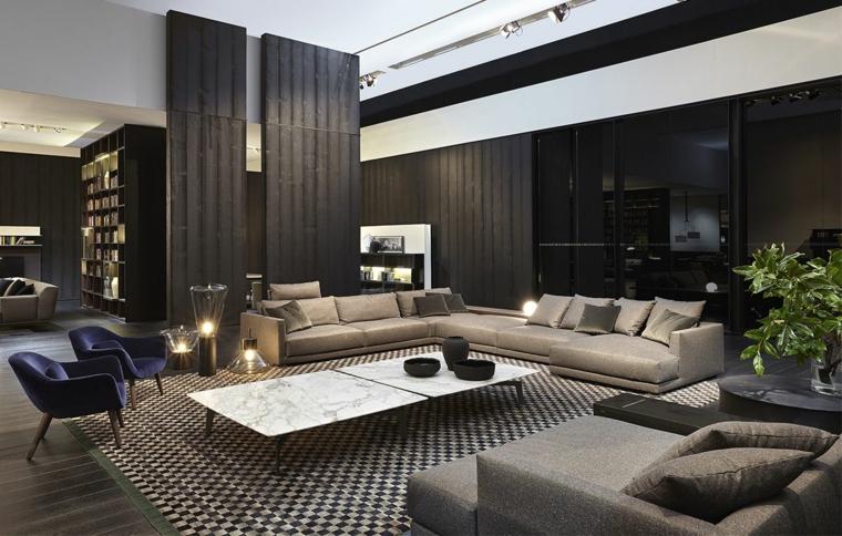 come arredare un soggiorno rettangolare divano tavolini bassi marmo tappeto faetti piante interno