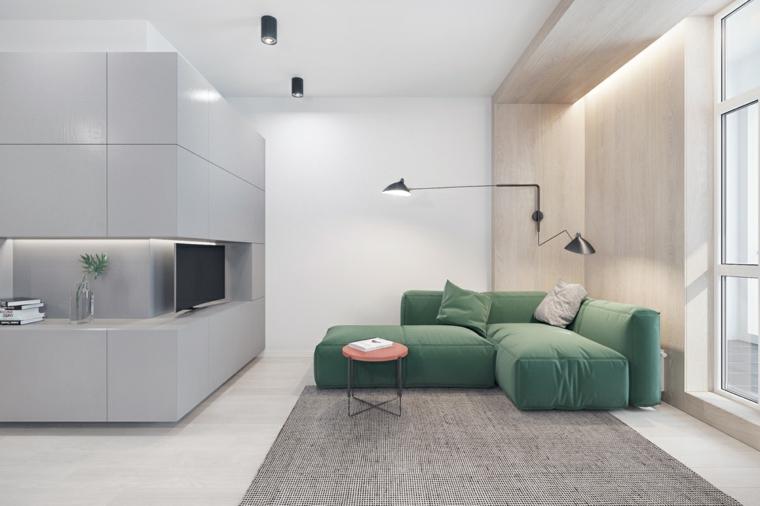 come arredare un soggiorno rettangolare divano verde parete attrezzata faretti lamapda tappeto