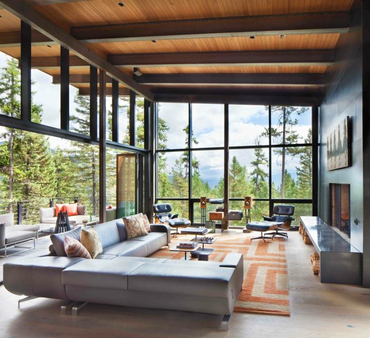 come arredare una sala e salotto insieme divano grigio tappeto finestre camino