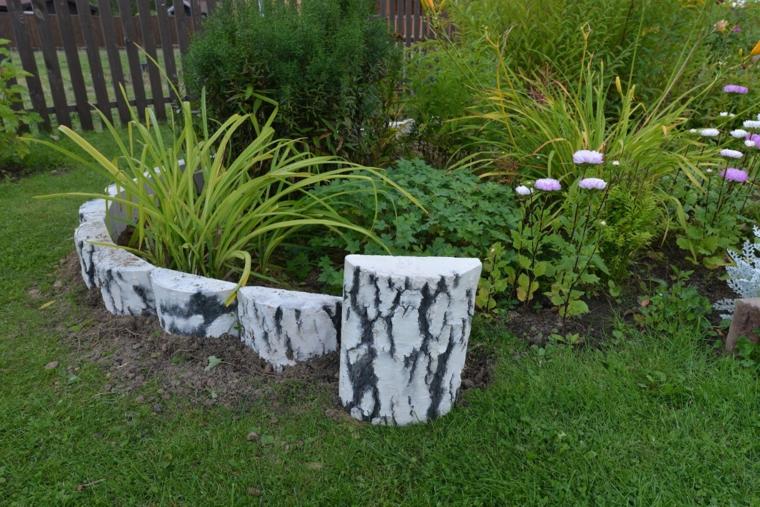 come fare aiuole in giardino prato verde piante foglie mattoni effetto legno bianco