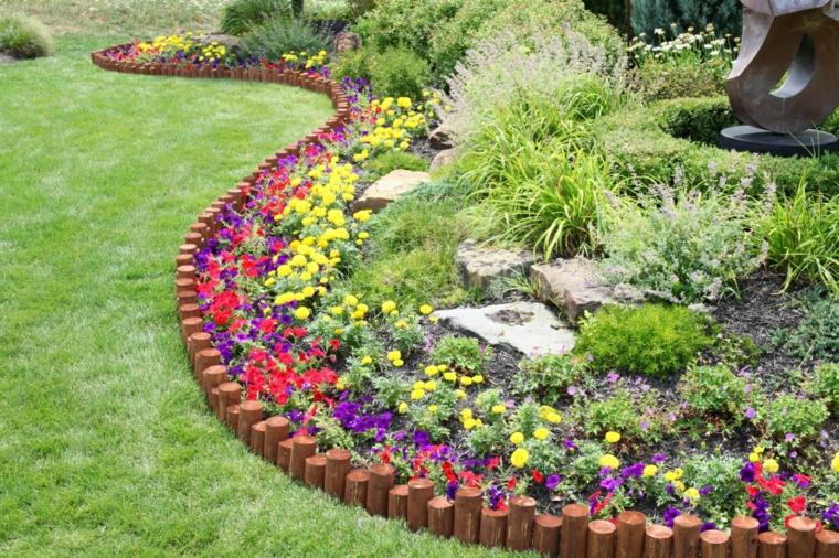 come posso abbellire il mio giardino fiori piante tronchetti legno piante