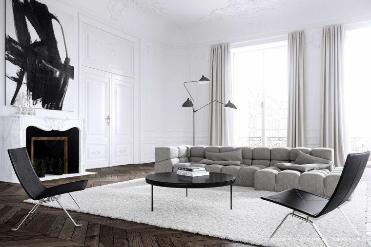 divano grigio tavolino nero sedie finestre tende lampadario decorazione quadro