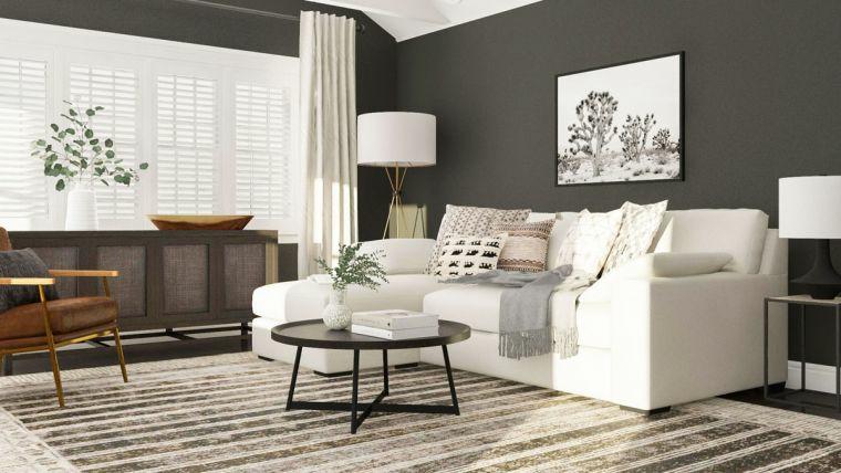 idee arredamento soggiorno divano bianco tavolino rotondo nero sedia parete nera