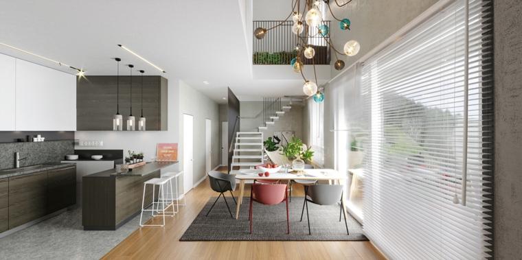open space scale interne cucina angolare con isola sgabelli tavolo da pranzo lampadario