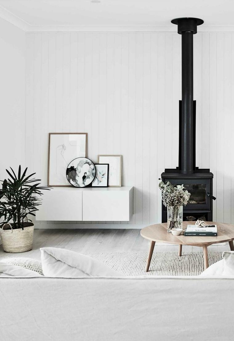 pianta da salotto con foglie rosse e verdi camino legna soggiorno tavolino stile scandinavo
