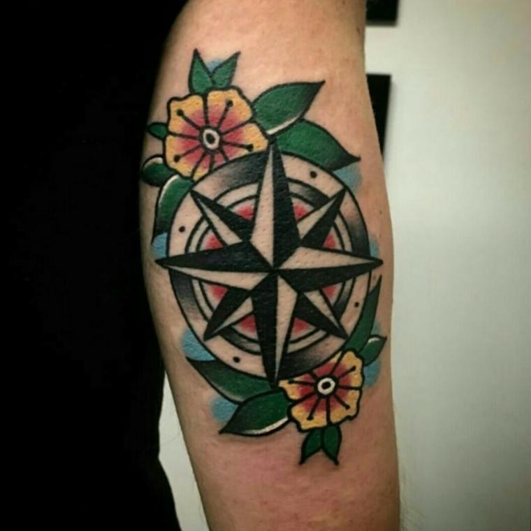 rosa dei venti old school tattoo braccio uomo stella cerchio petali foglie