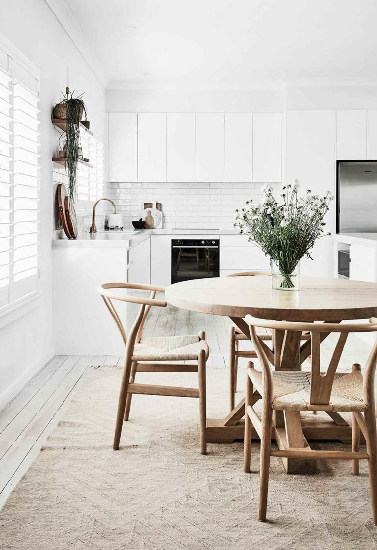 sala da pranzo tavolo vaso piante sempreverdi da interno cucina finestra tappeto