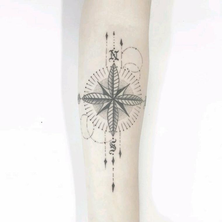 stella polare tattoo avambraccio donna disegno tatuaggio frecce mandala direzioni