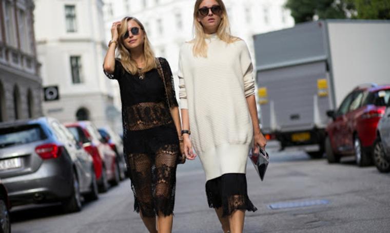 tagli capelli lunghi scalati a punta dietro due ragazze bionde occhiali da sole
