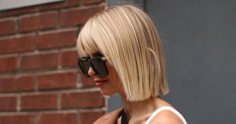 frangia a tendina viso tondo ragazza con capelli biondi taglio caschetto con frangetta
