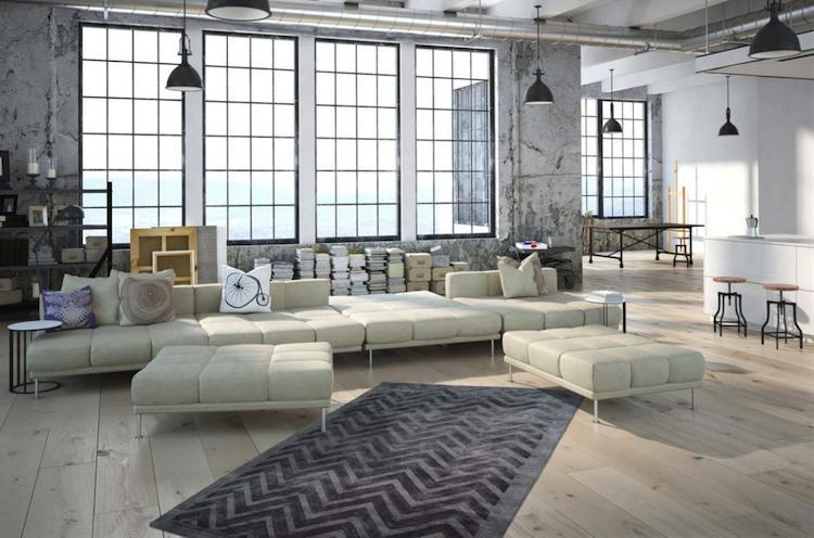 soggiorno in stile industriale con grandi finestre sotto legno chiaro piccolo tappeto grigio