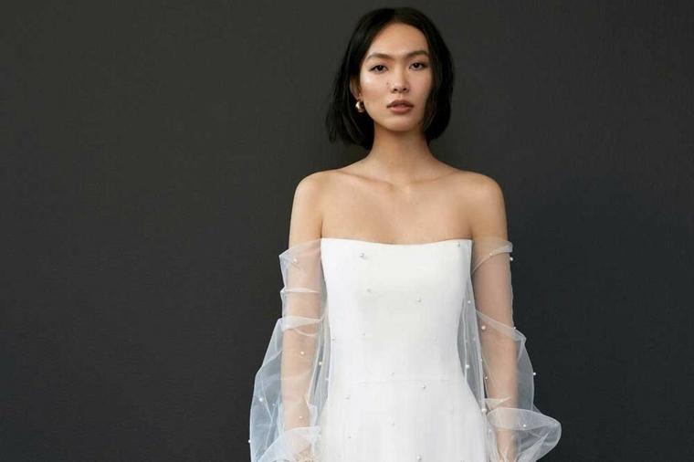 abiti da sposa 2021 tendenze vestito manica lunga in tulle trasparente donna capelli taglio caschetto