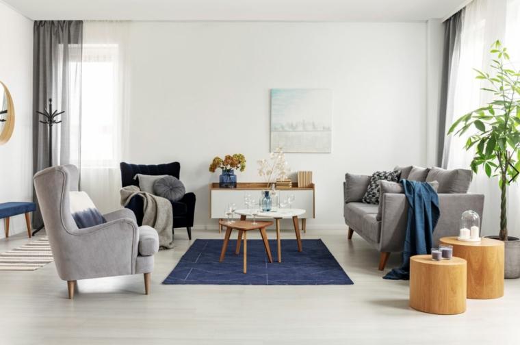 arredamento casa stile nordico divano grigio con poltrone decorazione salotto con tappeto blu