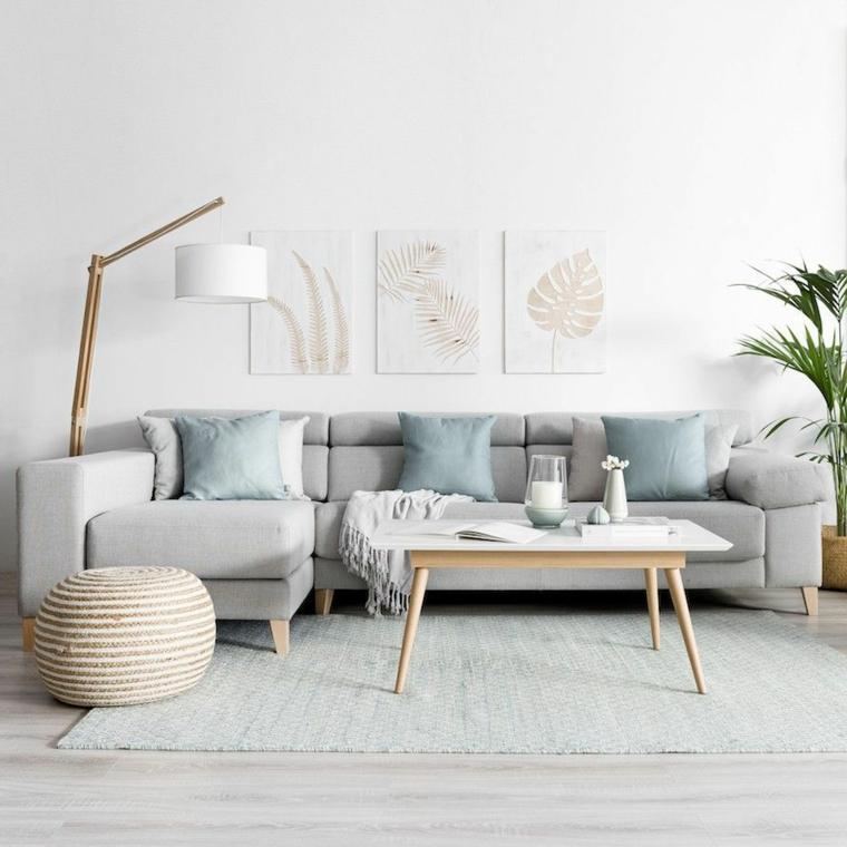 arredamento stile nordico divano grigio con cuscini salotto con pareti bianche