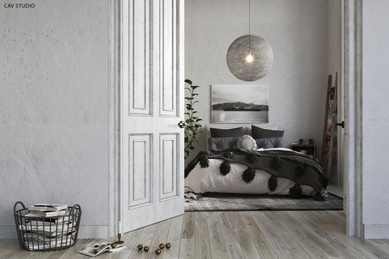 camera da letto stile scandinavo pavimento in legno con tappeto decorazione parete con quadro