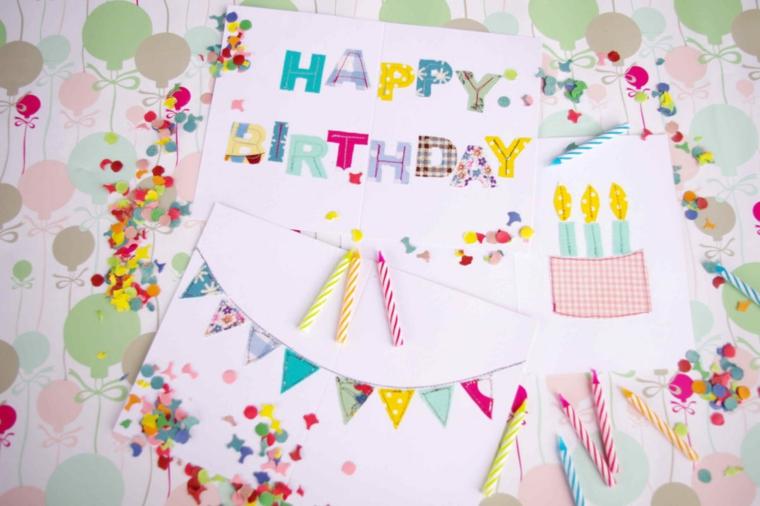 cartolina con scritta happy birthday disegno torta di compleanno con candeline