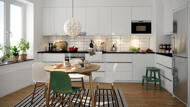 cucina stile nordico paraschizzi in piastrelle bianche tavolo da pranzo rotondo di legno