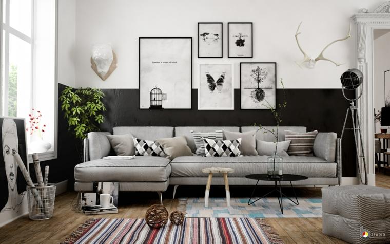 decorazione parete con quadri divano angolare grigio mobili salotto stile nordico