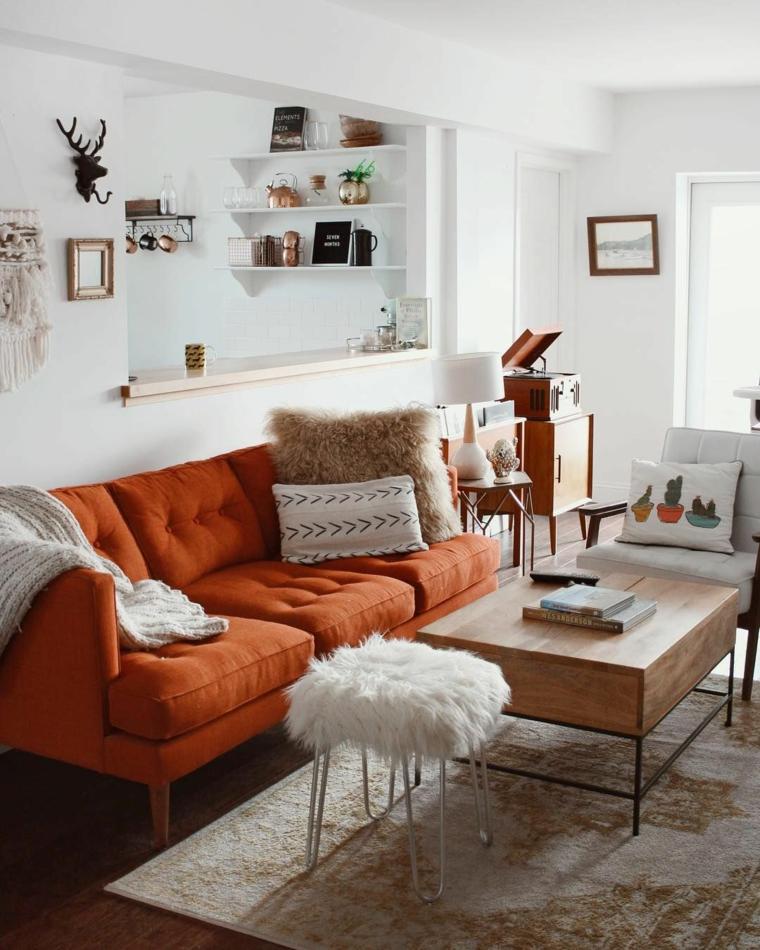 decorazione pareti soggiorno con quadri arredamento con divano arancione
