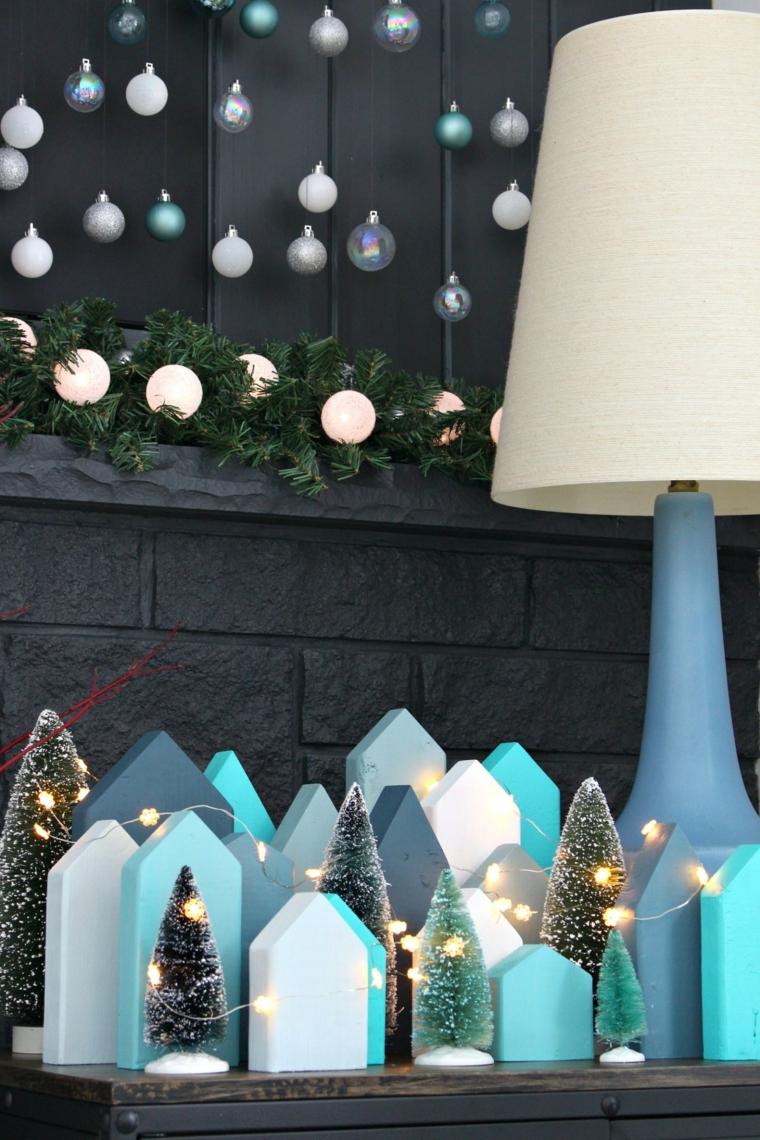 decorazioni natalizie fai da te 2020 villaggio con case di legno decorate con filo di lucine