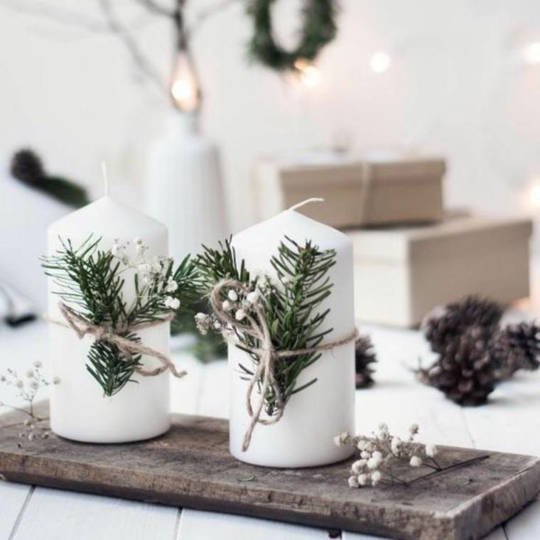 decorazioni natalizie particolari candele decorate con spago e rametti verdi