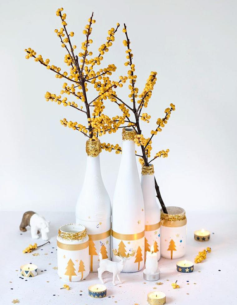 natale 2020 tendenze addobbi vasi dipinti di bianco con rametti candele e decorazioni