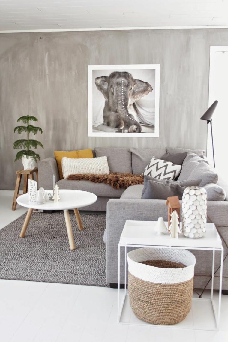 salotto stile scandinavo divano angolare grigio tavolino bianco rotondo
