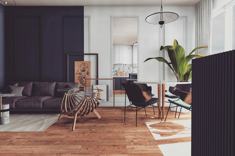 soggiorno con divano in pelle pavimento parquet scuro open space cucina salotto
