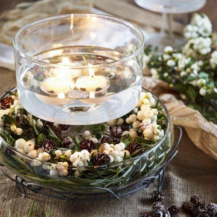 come fare un bel centrotavola ciotola di vetro con candele piatto con rametti verdi e mini pigne