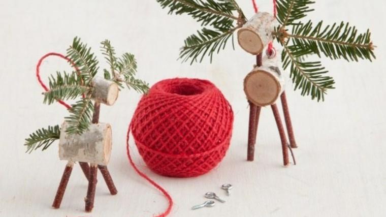 composizioni natalizie fai da te renne di piccoli tronchetti di legno e rametti
