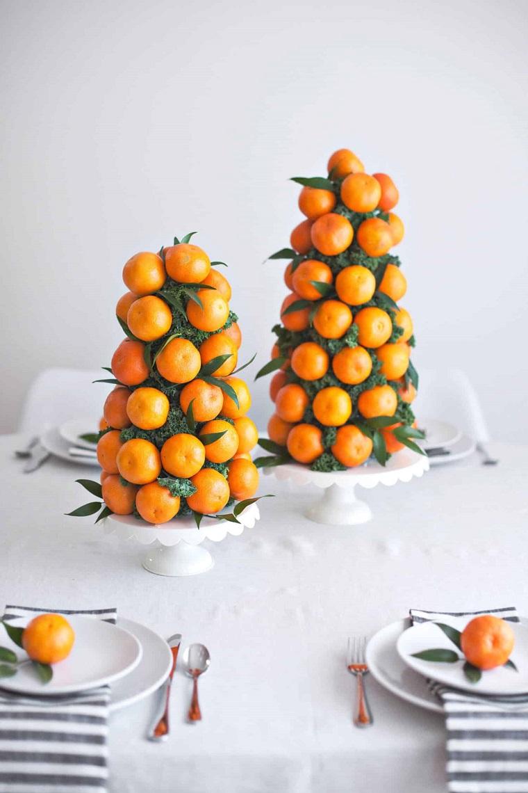 due piatti con mandarini addobbi tavola natalizia segnaposto di natale con clementine