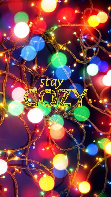 immagine per sfondo di natale con lampadine colorate e scritta