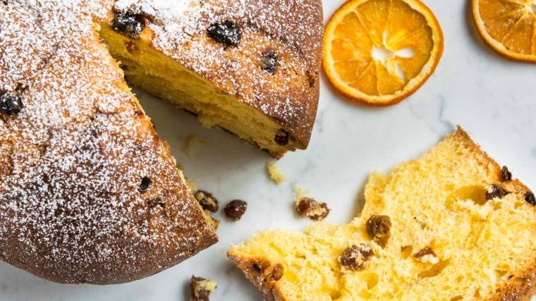 panettone classico con uvetta e pezzettini di arancia dolce ricoperto di zucchero a velo