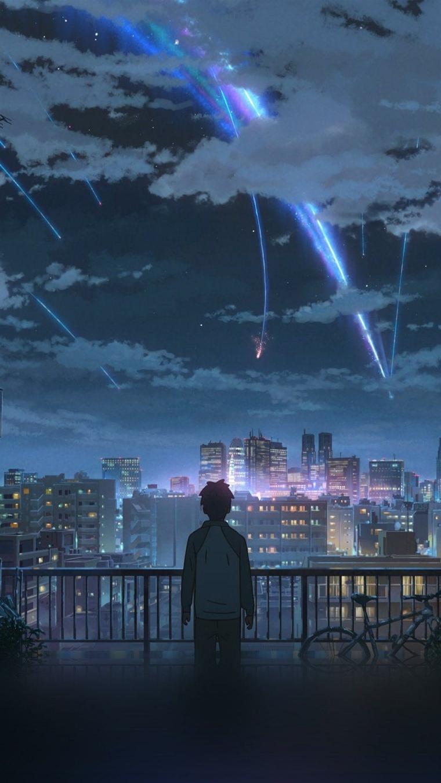 ragazzo che guarda città notturna sfondi manga per telefono