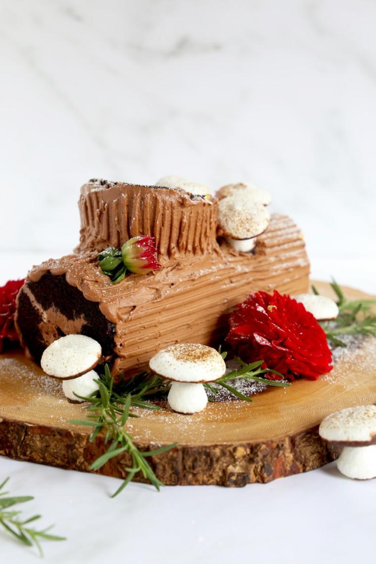 ricetta per il tronchetto natalizio al cioccolato al latte decorazione con funghi di meringhe