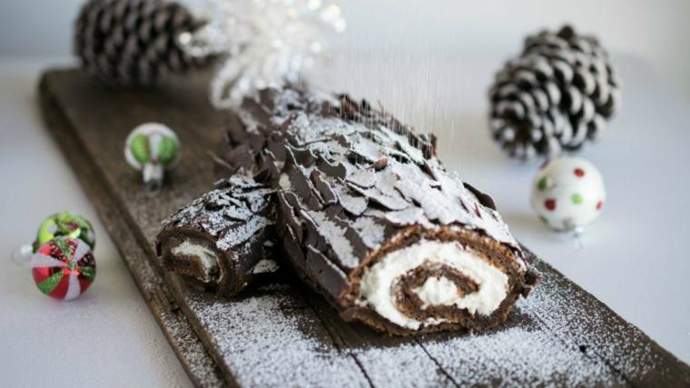 rotolo di tronchetto natalizio con crosto di cioccolato fondente e zucchero a velo