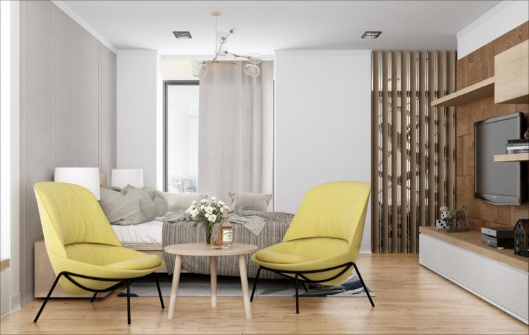 arredamento monolocale con letto due poltrone di colore giallo pareti dipinte di grigio chiaro