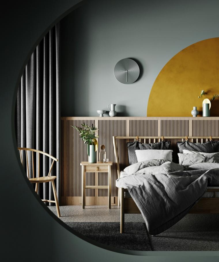 camera da letto con parete dipinta di giallo biancheria di colore grigio pantone