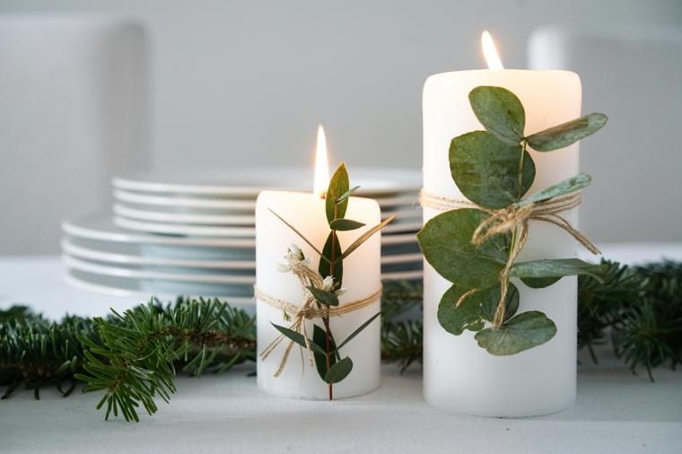 candele natalizie particolari candela decorata con rametto di foglie fissati con nastro di iuta