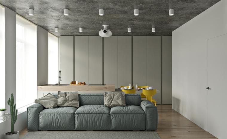 open space sala da pranzo e soggiorno divano in tessuto grigio sedie gialle